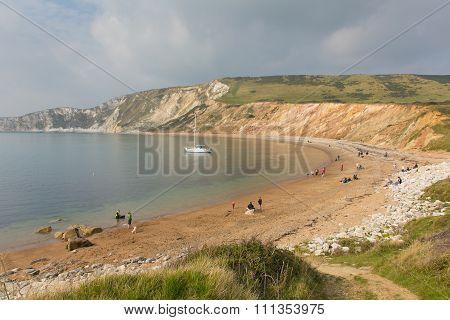 People on beach Worbarrow Bay east of Lulworth Cove and near Tyneham on the Dorset coast England uk