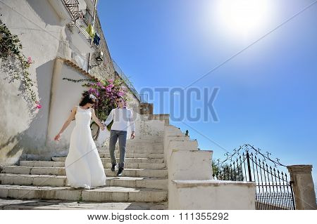 Beautiful Couple Bride And Groom In A Sunny Day in Sperlonga, Italy