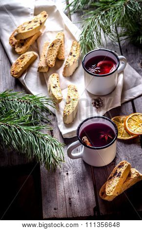 Two Mugs Of Mulled Wine  And Italian Biscotti Cookies On Wooden Table.style Rustic.
