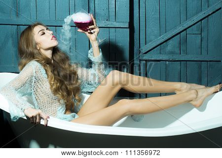 Woman With Glass In Bath