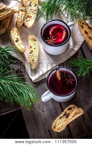 Two Mugs Of Mulled Wine  And Italian Biscotti Cookies On Wooden Table.