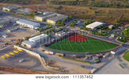 Aerial View Of Compact Baseball And Football Field.