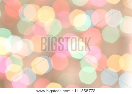 Defocused red, yellow, orange, magenta lights on beige background
