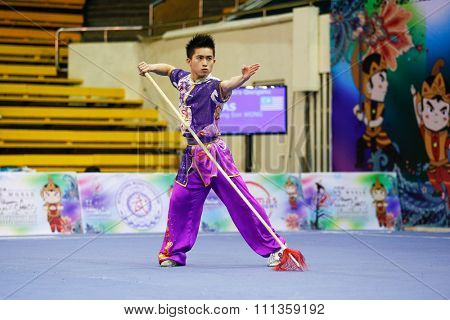 JAKARTA, INDONESIA - NOVEMBER 17, 2015: Wong Weng Son of Malaysia performs the movements in the men's Qiangshu event at the 13th World Wushu Championship 2015 at the Istora Senayan Stadium.