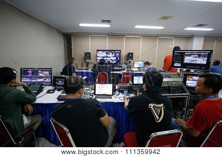JAKARTA, INDONESIA - NOVEMBER 16, 2015: Wushu TV broadcast crew works in the master control room to provide live streaming telecast of all the events at the 13th World Wushu Championship 2015.