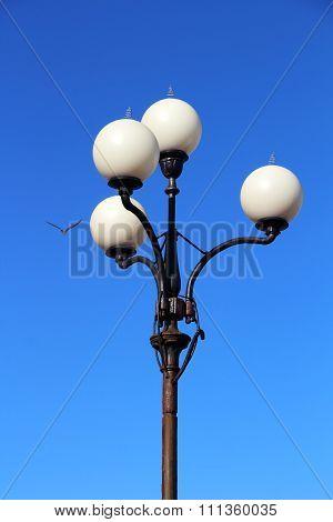 Street lantern against the blue sky