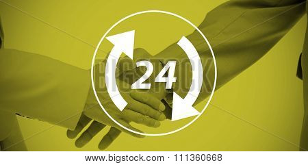 Close up of business people shaking their hands against twenty four and arrows