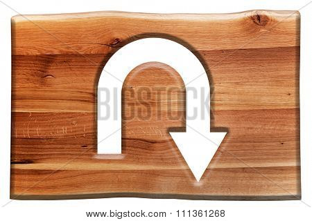 U-turn sign cut in wooden board isolated on white. Natural oak wood. Background, texture