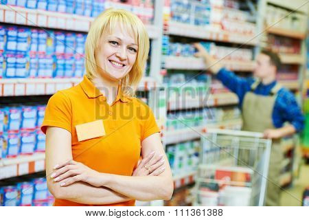 Happy female seller or shop assistant portrait  in hardware supermarket store