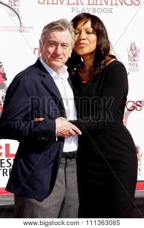 Robert De Niro and Grace Hightower at the Robert De Niro Hand and Footprint Ceremony held the TCL Chinese Theatre in Hollywood on April 2, 2013.