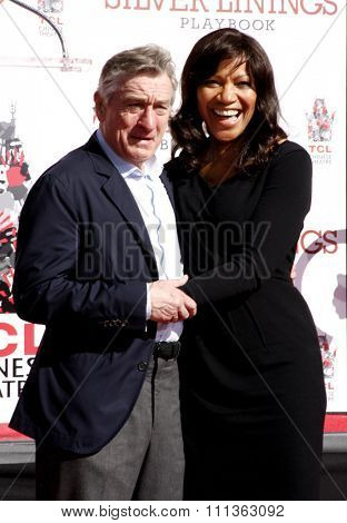 Robert De Niro and Grace Hightower at the Robert De Niro Hand and Footprint Ceremony held the TCL Chinese Theatre in Hollywood on April 2, 2013