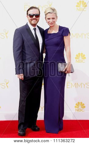 Jane Fallon and Ricky Gervais at the 66th Annual Primetime Emmy Awards held at the Nokia Theatre L.A. Live in Los Angeles on August 25, 2014.