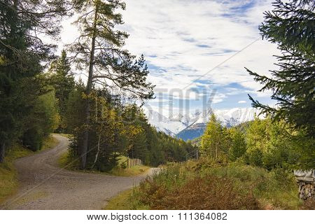Alpine Dirt Road With Snowy Mountain Range
