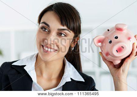 Happy Beautiful Woman Shaking Funny Piggybank And Listening