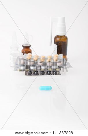 Blue pill and different medications behind