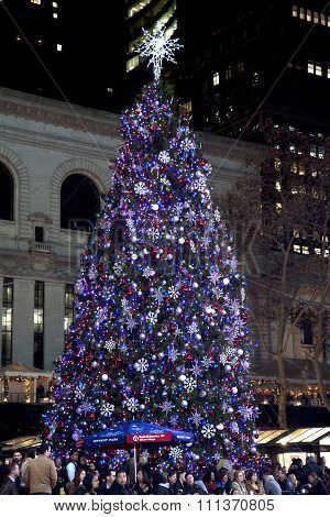 People In Bryant Park With Christmas Tree In Background