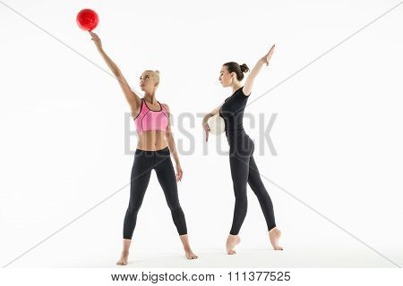 Two girls with balls