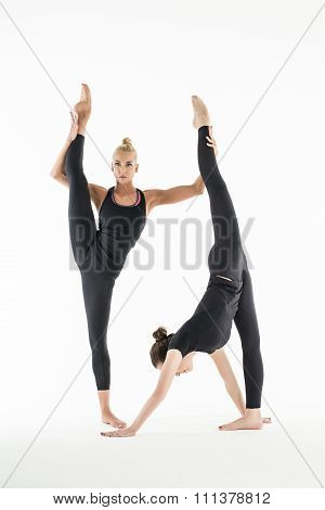 Two girls stretch