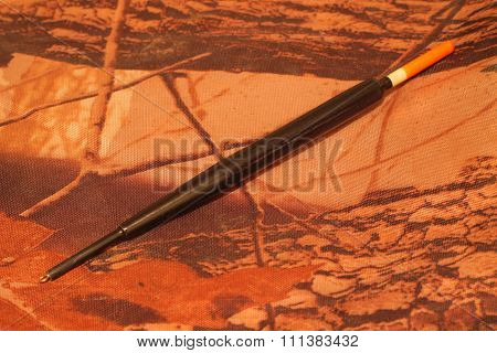 fishing tackle on a camouflage background