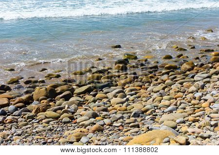 Breezy Beach, Rocks and Pebbles Background