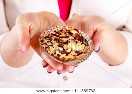 Delicious Sweet Cupcake In Human Hands. Gluttony