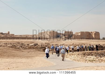 Tourists Visiting The Fort Of Bahrain