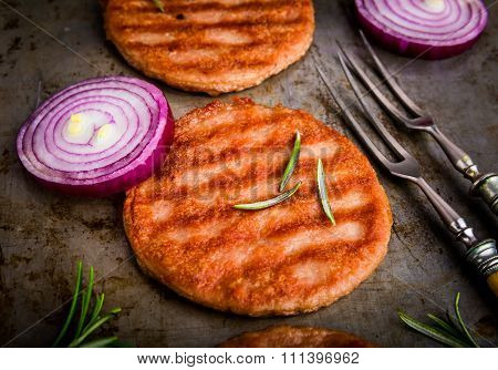 Chicken Steak With Red Onions And Rosemary On A Tinware