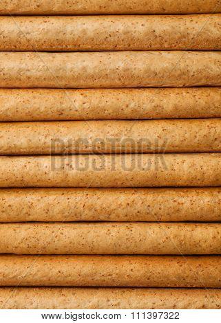 Breadsticks grissini stack background