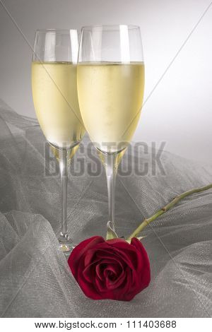 Two Glasses of Champagne and a Single Red Rose
