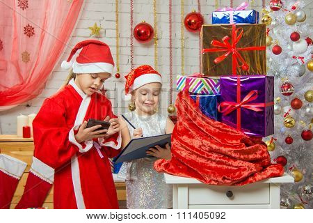 Santa And Helper Find Gifts In A Bag
