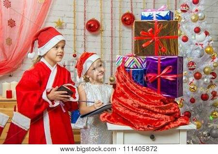 Santa Claus Helper And Collate A List Of Gifts
