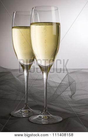Two Glasses of Sparkling Wine Backlit