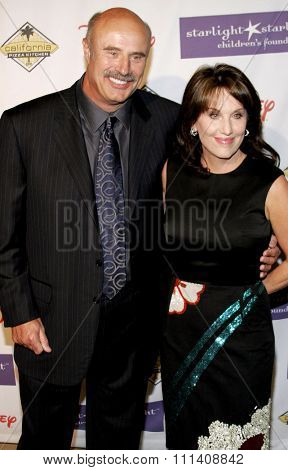 Dr. Phil McGraw and wife Robin McGraw attend the 2007 Starlight Starbright Children's Foundation Gala held at the Beverly Hilton Hotel in Beverly Hills, California on March 23, 2007.