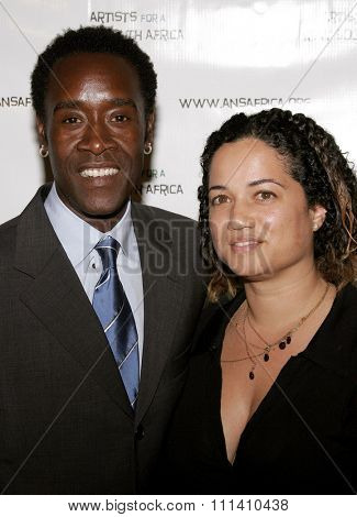 Don Cheadle and Bridgid Coulter attend the Archbishop Desmond Tutu's 75th Birthday Celebration held at the Regent Beverly Wilshire Hotel in Beverly Hills, California on September 18, 2006.