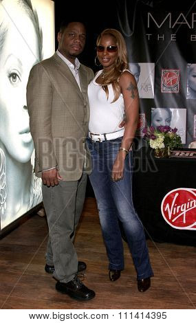 Mary J. Blige and husband Kendu Isaacs. Mary J. Blige signs her latest hit CD The Breakthrough held at the Virgin Megastore Hollywood & Highland in Hollywood, California on January 13, 2006.