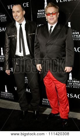 David Furnish and Elton John attend the Rodeo Drive Walk Of Style Award honoring Gianni and Donatella Versace held at the Beverly Hills City Hall in Beverly Hills, California on February 8, 2007.
