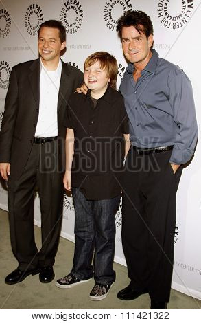 Jon Cryer, Angus T. Jones and Charlie Sheen attend the