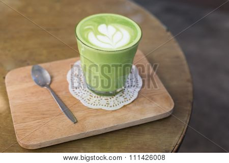 Green Tea Latte On Wood Background