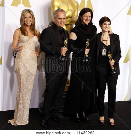 Jennifer Aniston, Dirk Wilutzky, Laura Poitras and Mathilde Bonnefoy pose in the press room during the 87th Annual Academy Awards at Loews Hollywood Hotel on February 22, 2015 in Hollywood.