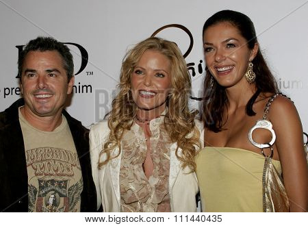 November 17, 2005 - Beverly Hills - Christopher Knight, Paige Adams-Geller and Adrianne Curry at the Paige Premium Denim Party at the Paige Premium Denim Flagship Store in Beverly Hills.