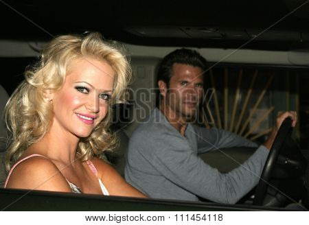 19 August 2004 - Hollywood, California - Lorenzo Lamas and Barbara Moore. Pelle Pelle's Celebrity Catwalk for charity hosted by Nicole Richie at the Palladium in Hollywood.