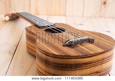 The Ukulele On Wooden Background