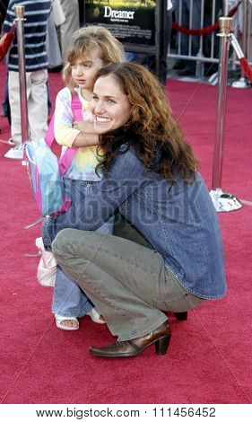 WESTWOOD, CALIFORNIA. October 9, 2005. Amy Brenneman and daughter Charlotte at the DreamWorks Pictures Premiere of 'Dreamer' at the Mann Village Theatre in Westwood, California United States.
