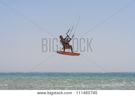 Kite Surfer Rides The Waves.