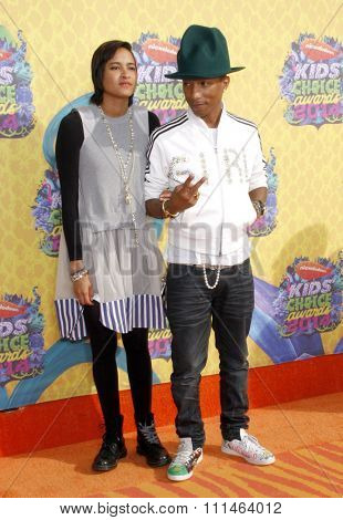 Pharrell Williams and Helen Lasichanh at the Nickelodeon's 27th Annual Kids' Choice Awards held at the USC Galen Center in Los Angeles on March 29, 2014 in Los Angeles, California.