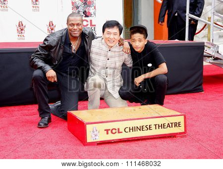 Chris Tucker, Jackie Chan and Jaden Smith at the Jackie Chan Hand and Foot Print Ceremony held at the TCL Chinese Theatre in Hollywood in Los Angeles, United States, 060613.
