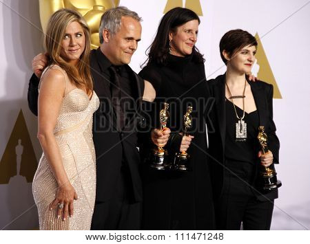 Jennifer Aniston, Dirk Wilutzky, Laura Poitras and Mathilde Bonnefoy at the 87th Annual Academy Awards Press Room held at the Loews Hollywood Hotel in Hollywood on February 22, 2015.