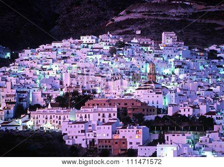 Monda village at night.