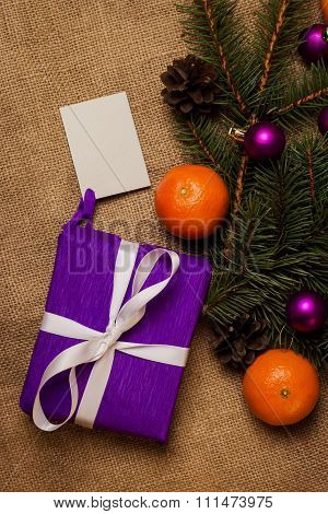 Gift With Postcard And Christmas Decorations