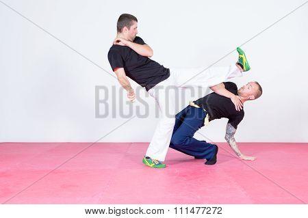 Two Men Dancing Capoeira
